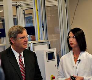 Ag Secretary Tom Vilsack speaks with a researcher during a recent visit to the Dupont Pioneer lab in Johnston.