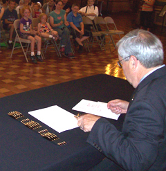 Governor Branstad signs the bill into law.