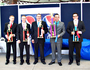 Tyler Runge (second from right) won the auctioneering contest held at the Iowa State Fair.