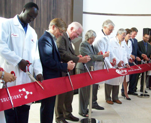 Officials cut a giant ribbon at the expanded Kemin facility.