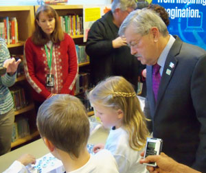Students show the governor a STEM project.