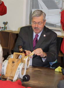 Governor Branstad labels the one millionth Templeton Rye bottle.