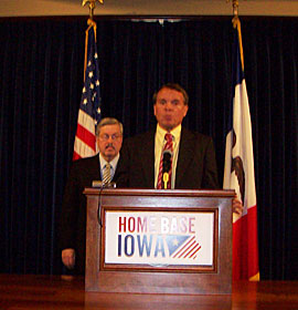 Ken Paxton (podium) and Governor Terry Branstad.