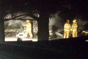 Firefighters on the scene of fatal fire near Arlington.