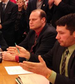 Representative Josh Byrnes (left)