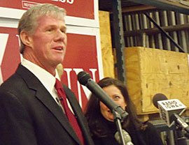 Brad Zaun talks about running for congress as his wife looks on.