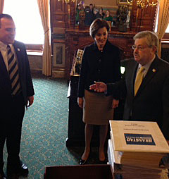 Secretary of State Matt Schultz (left) accepts petitions from Governor Terry Branstad and Lt. Governor Reynolds.