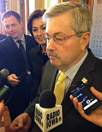 Governor Branstad talks with reporters.