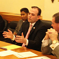 Secretary of State Matt Schultz and deputy Charlie Smithson speak with legislators.