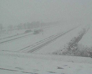 A DOT traffic camera shows a snowy Highway 20 in Waterloo.