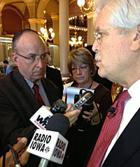 Jack Hatch (right) talks with reporters.