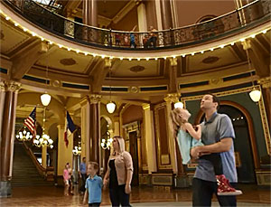 One of the new tourism ads shows visitors to the state capitol building.