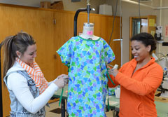 Amber Hain, Kierra Canier with pediatric gown created in their ISU class.