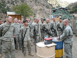 Members of 1st Platoon, Chosen Company, 2nd Battalion (Airborne), 503rd Infantry Regiment, 173rd Airborne Brigade gather for a ceremony in Nuristan Province, Afghanistan, Nov. 6, 2007 (three days before the enemy ambush).