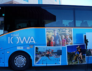 Tourism officials will travel on a  bus decorated with pictures of Iowa attractions.