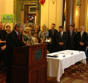 Governor Terry Branstad talks to supporters before signing the canabis oil bill.