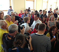 Mitt Romney talks with a supporter during a rally for Joni Ernst in Cedar Rapids.