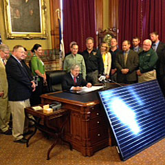 Governor Branstad signs the solar energy bill.