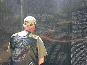 A Vietnam veteran looks for the names of fallen comrades.