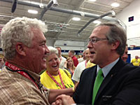 David Young talks with a supporter.