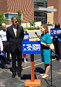 Iowa Democratic Party chair Scott Brennanan (L) with DNC chair Wasserman Schultz.