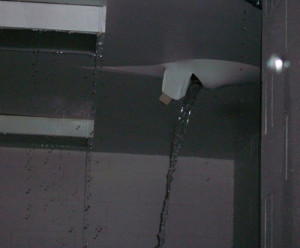 Water pours through the roof of the Newton prison.  (Department of Corrections photo)
