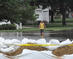 A man walks through flood water in Rock Valley on June 18th.