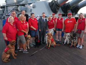 Actor Gary Sinise (in suit) at the USS Iowa fundraiser.