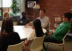 Bruce Braley talking with college students at Drake University.