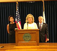 Teresa Wahlert of Iowa Workforce Development talks during Governor Branstad and Lt. Governor Reynold's weekly news conference.
