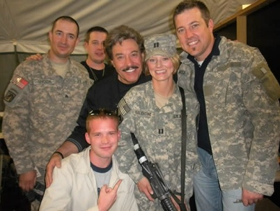 Tony Orlando (in black) visits US troops in Iraq