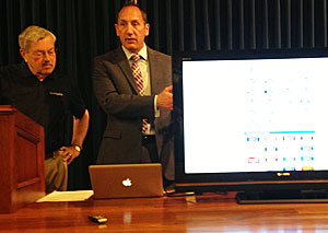 DOT director, Paul Trombino demonstrates online license plate registration to the governor.