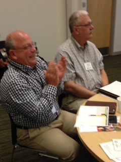 Jon Wibbels of AEA in Sioux City applauds speaker at symposium.