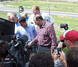 File photo from 2010 Steak Fry: Harkin, Obama advisors David Axelrod & David Plouffe flip steaks.
