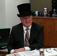 Iowa Lottery CEO wears a top hat to promote the new Monopoly-themed game.