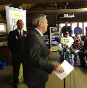 State Representative Chip Baltimore listens as Governor Terry Branstad speaks.