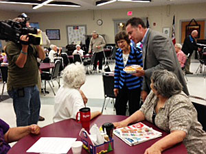 Bruce Braley & his mother visit with residents of a Des Moines senior center.