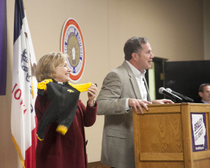 Bruce Braley presented Hillary Clinton with a Hawkeye outfit for her grandbaby.
