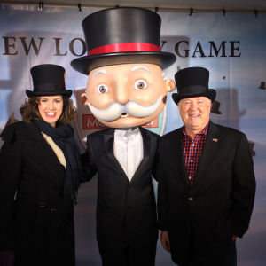 Iowa Lottery VP, Mary Neubauer and CEO Terry Rich with Monopoly's Mr. Money.