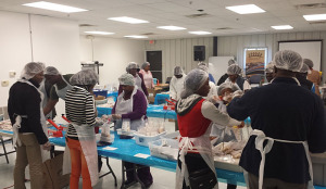 Liberians in Iowa gathered at Outreach's warehouse in Des Moines on Oct. 4,  to package meals to send to Ebola patients in Liberia West Africa.