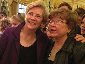 Elizabeth Warren poses for pictures after speaking in Des Moines.