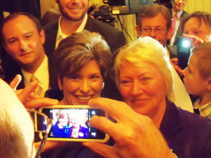 Joni Ernst poses for a picture with a supporter after her victory speech Tuesday.