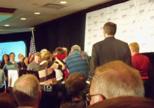 Joni Ernst hugs supporters following her victory speech.
