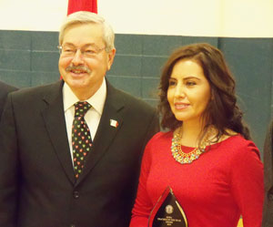 Governor Terry Branstad and Teacher of the Year, Clemencia Spizzirri.