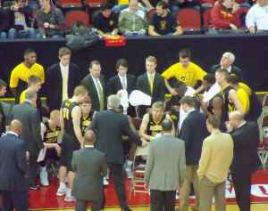 The Iowa bench in a timeout during the Big 4 Classic.