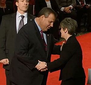 New Jersey Governor Chris Christie is greeted by Iowa Senator Joni Ernst.