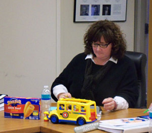 Diane Crookham-Johnson used corn dogs and toy school bus during the school start discussion.