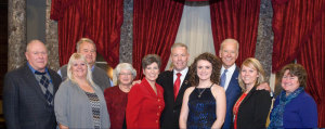 Joni Ernst and her family along with the Vice President.