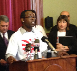 Justin Banks speaks at the news conference.