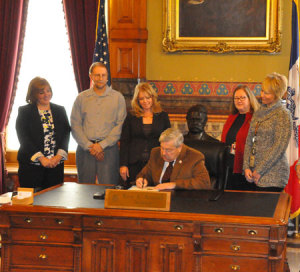 "Governor Terry Branstad signs a proclamation declaring January ""Radon Action Month."""